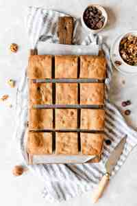 top view of blondie squares on wooden chopping board