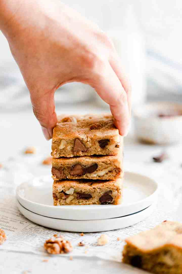 side close up of a hand reaching for a blondie bar
