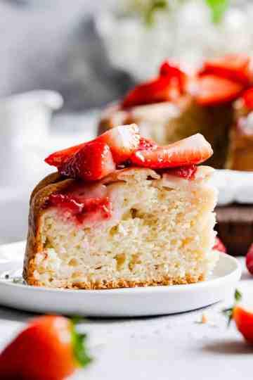 super close up of a slice of fresh strawberry yogurt cake
