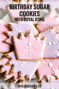 super close up at crown-shaped sugar cookies with royal icing and text overlay