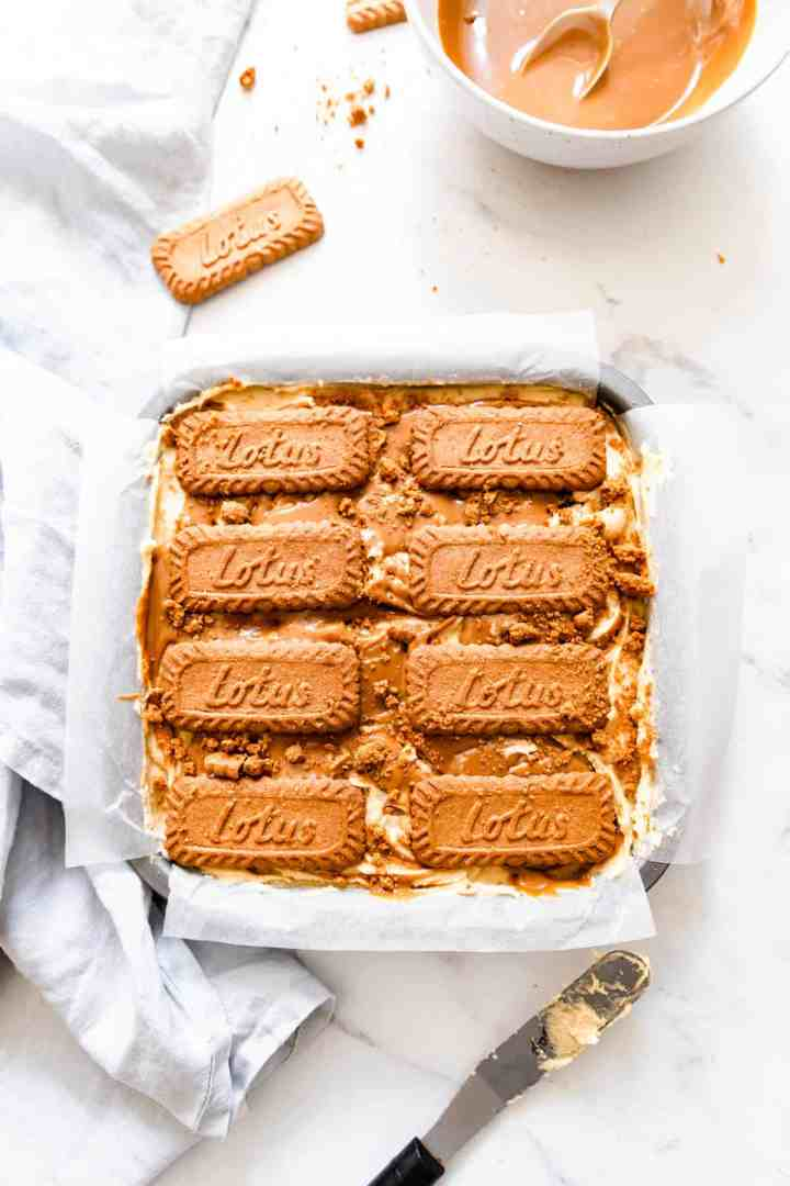 overhead shot of baking tin with biscoff blondies