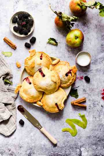 overhead shot of spiced apple and blackberry hand pies with some juices oozing out from them