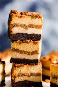 side super close up at a stack of three pumpkin cheesecake bars