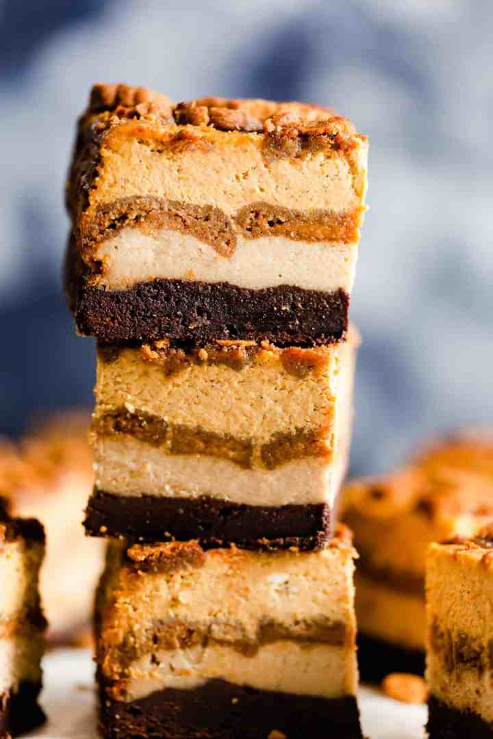 side super close up at a stack of three pumpkin cheesecake bars