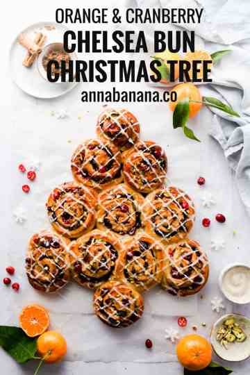 overhead shot of orange and cranberry Chelsea buns shaped into a Christmas tree with text overlay