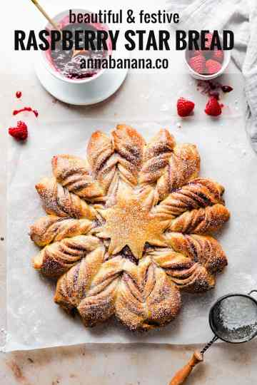 top view of a raspberry star bread dusted with icing sugar with text overlay