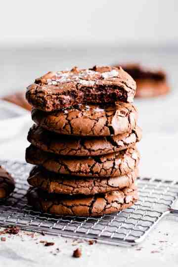 side close up at stack of browne cookies with a bite missing from the top cookie