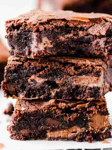 straight ahead super close-up of 3 chocolate brownies stacked on top of each other