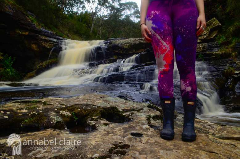 Chasing Waterfalls wearing Nike leggings and Hunter Boots at Swallow Cave Falls