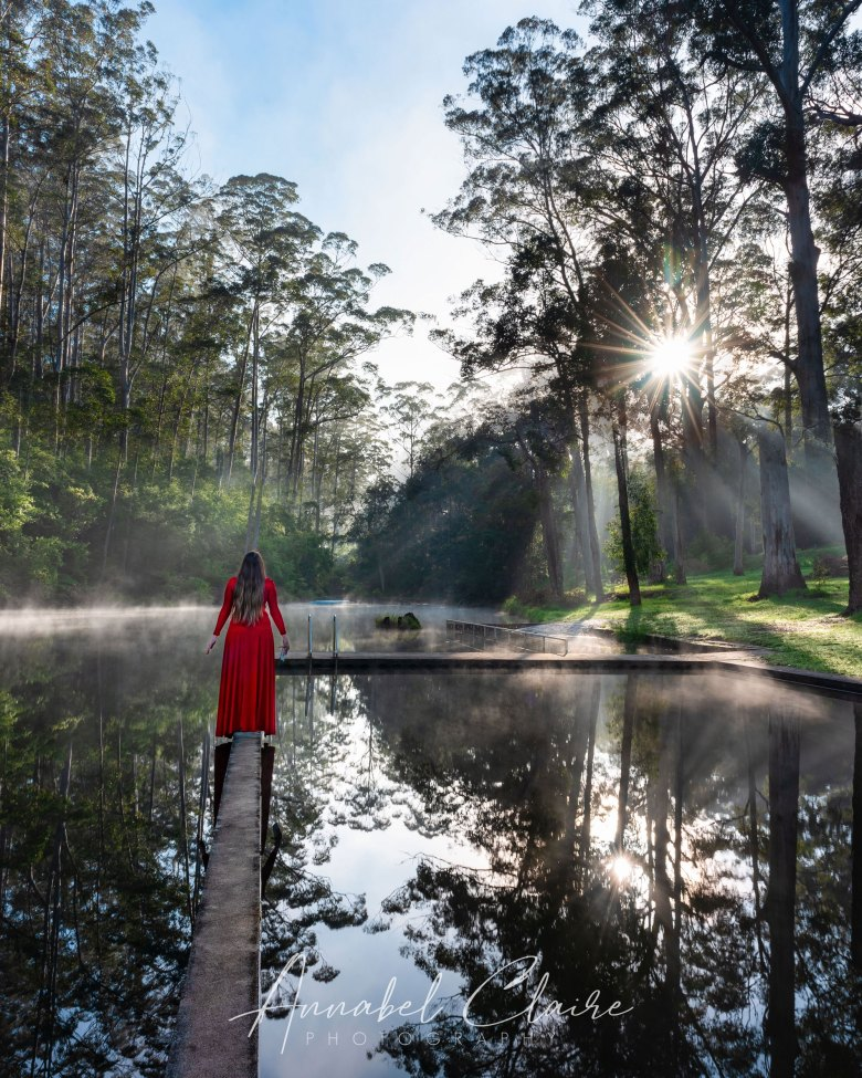 Girl in red dress at Pemberton Pool to show morning mist and beauty of natural environment