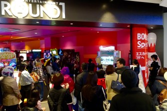 The crowd watching a Dance Revolution 'master'