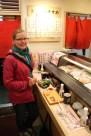 Anna at a stand up sushi bar - yum!
