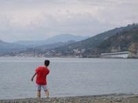 Tom skipping stones in Sestri Levante