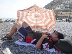 Matt found some free shade on the beach in Positano