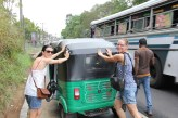 Greta and Anna helping the tuk tuk that failed to proceed in Kandy