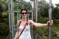 Greta very happy to be on a suspension bridge at the Kandy Botanical Gardens
