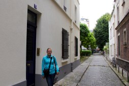 Anna outside her old apartment in Paris