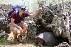 Ben with a giant land tortoise on San Cristobal Island, Galapagos