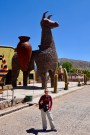Anna with a giant llama at a ceramics factory in Humahuaca, Argentina