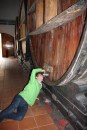Ben trying to get a taste of some wine at Bodega Lopez, Maipu, Argentina
