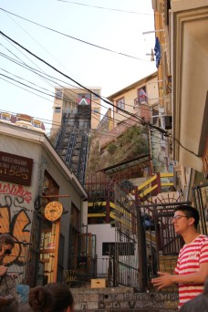 Our 'Tours for Tips' guide showing us one of the many public elevators in Valparaiso, Chile
