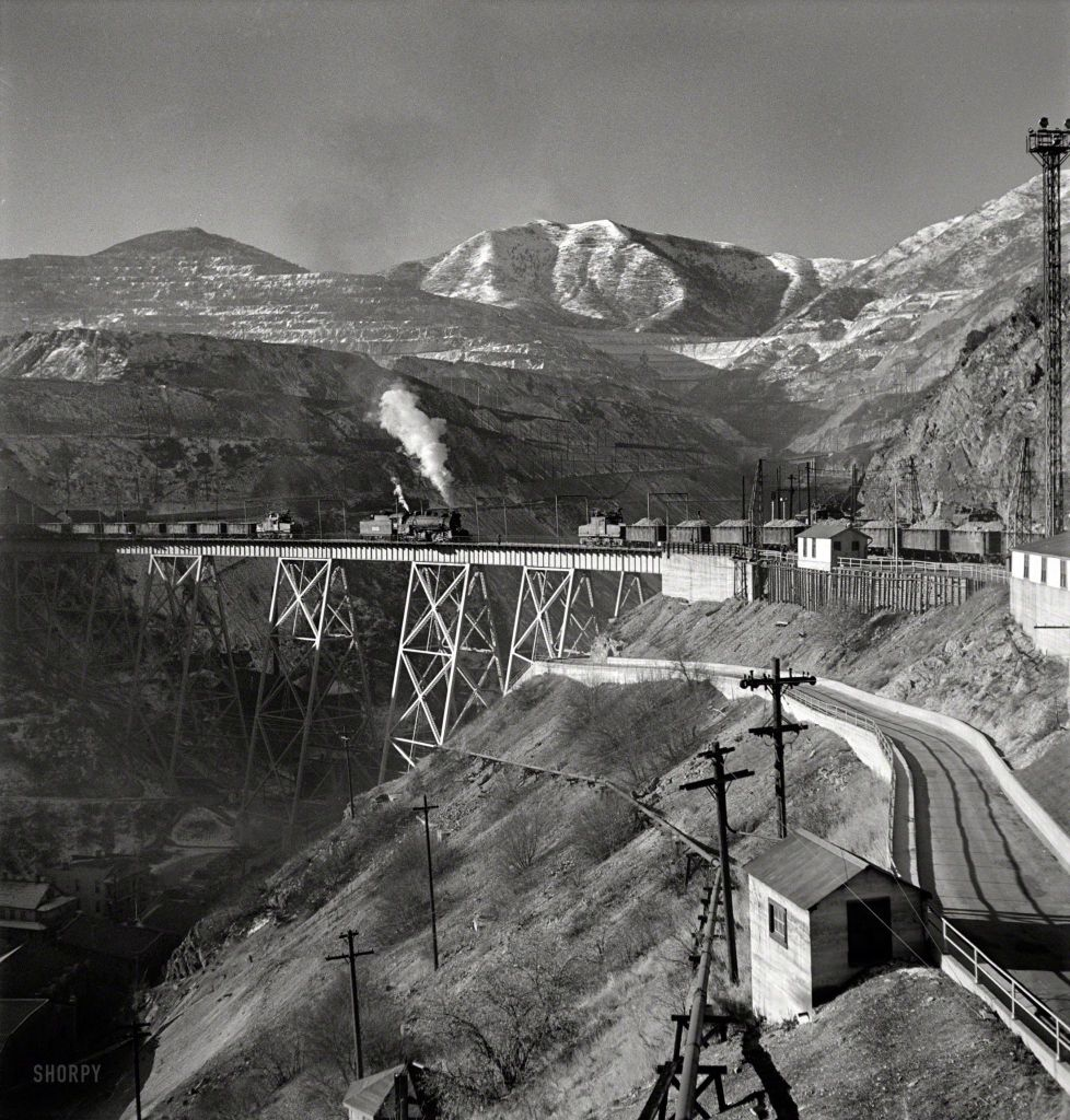 "November 1942. ""Bingham Canyon, Utah. Ore trains on a trestle bridge above an open-pit mine of the Utah Copper Company."" Photo by Andreas Feininger for the Office of War Information."