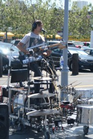 Another street musician. One-man-band at its ultimate peak of coolness. Playing an electric guitar, a bass, and a keyboard with his hands, singing, and playing drums and cymbals and other stuff with his feet. So epic.