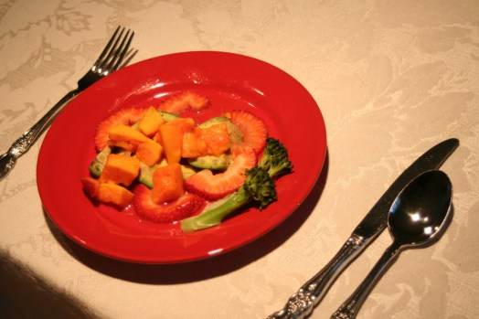 Food. Avocado topped with papaya and strawberries and garnished with broccoli. Yum.