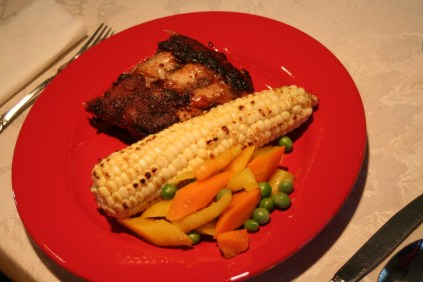Dinner. so good. One of my facvorites since we've been here. =D Pork ribs and corn and veggies from the garden.
