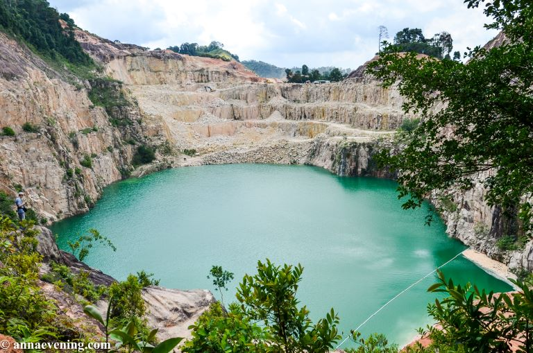 turquoise-colored lake in a stone quarry