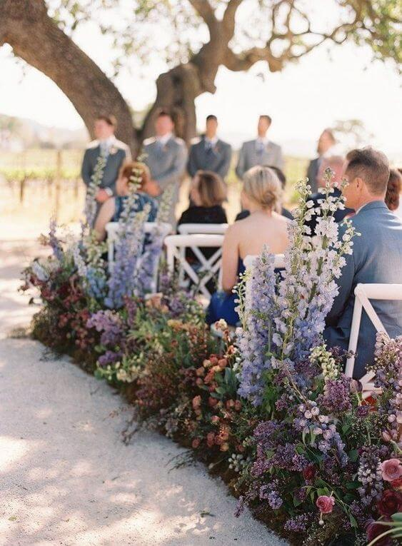 wedding ceremony aisle made with delphinium flowers
