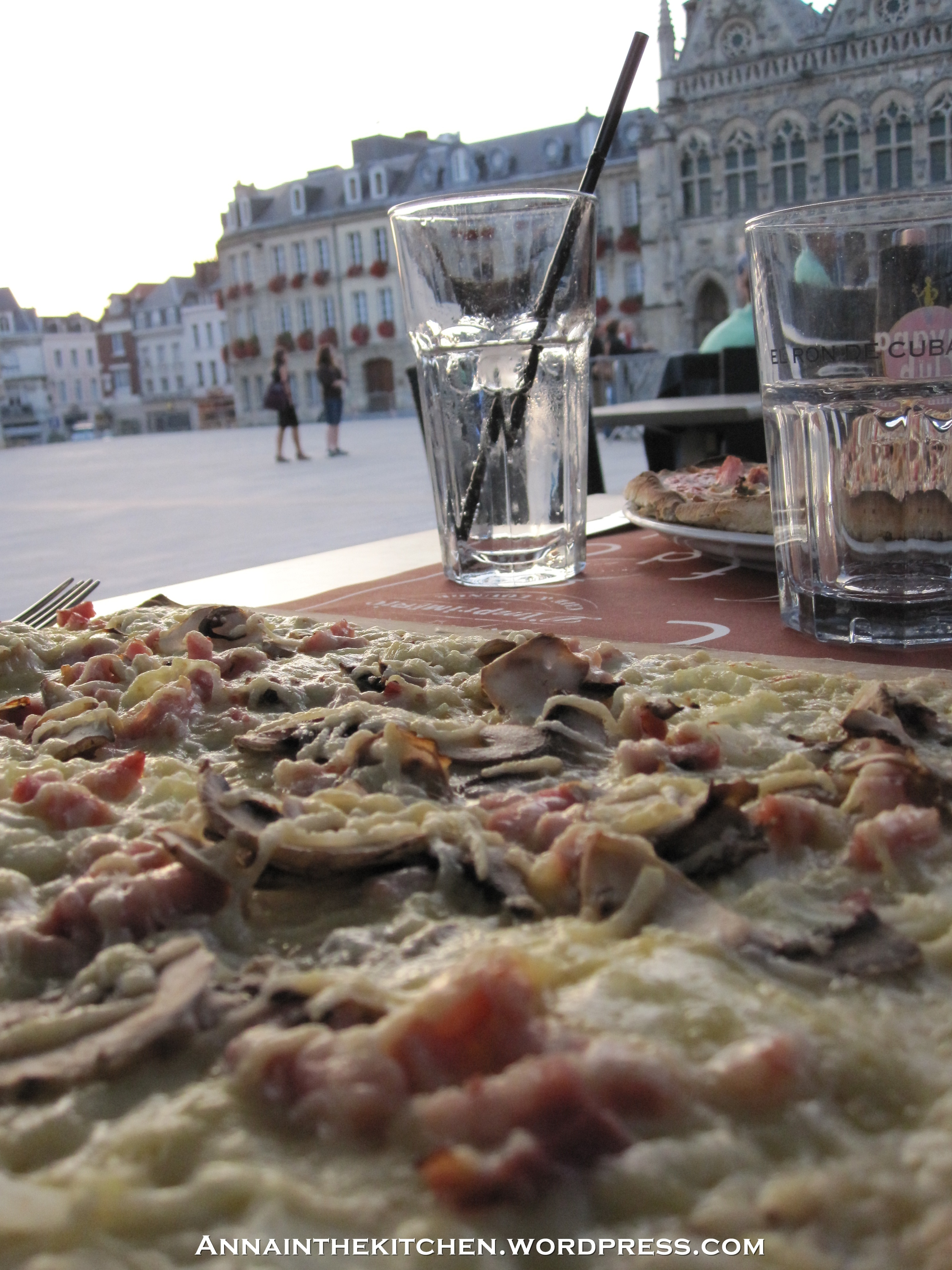 Sitting in St Quentin town square eating dinner.