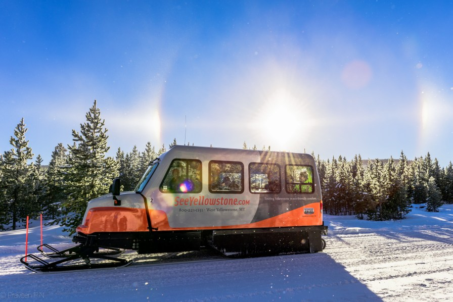 Sun dogs and Diamond dust around a snowcoach