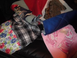 A row of quilt squares from Mary & AnnaLeah's clothes. For Quilt Number Two