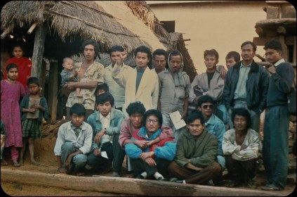 """Samana Cultural Family with locals in Makwanpur, sometime after the start of the """"People's War"""" in 1996."""