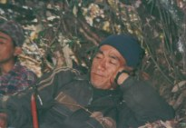 Khusiram Pakhrin hiding from the Royal Nepal Army in a rhododendron forest while returning from the Beni front.