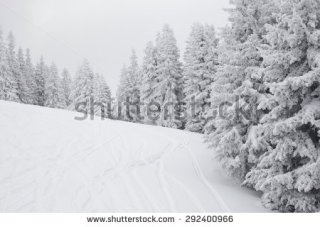 Snow covered ski slope with fresh tracks in foggy weather, twice