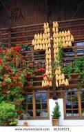 stock-photo-wooden-house-facade-decorated-with-corn-cross-igls-tirol-austria-81816571