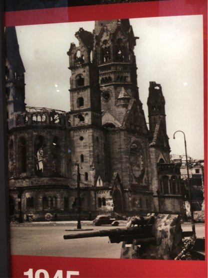 Kaiser Wilhelm Memorial Church after bombing in 1943 and and during street battles in 1944