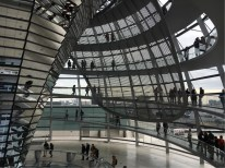 A large structure is slowly moving around the Dome to ensure that no direct sunlight dazzles the members sitting below