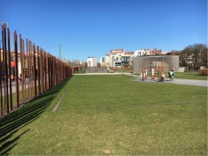 Looking along the 'no man's land' with Wall markers on the left and the new Reconciliation Chapel in the distance.