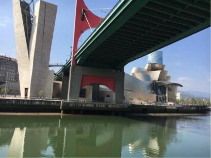 Museo Guggenheim, designed to extend under the five story high Salbeko Zubia bridge.