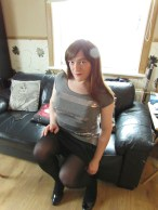 Redhead couch posing