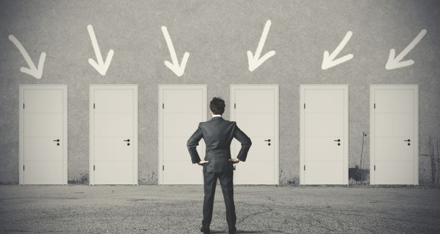 Businessman choosing the right door
