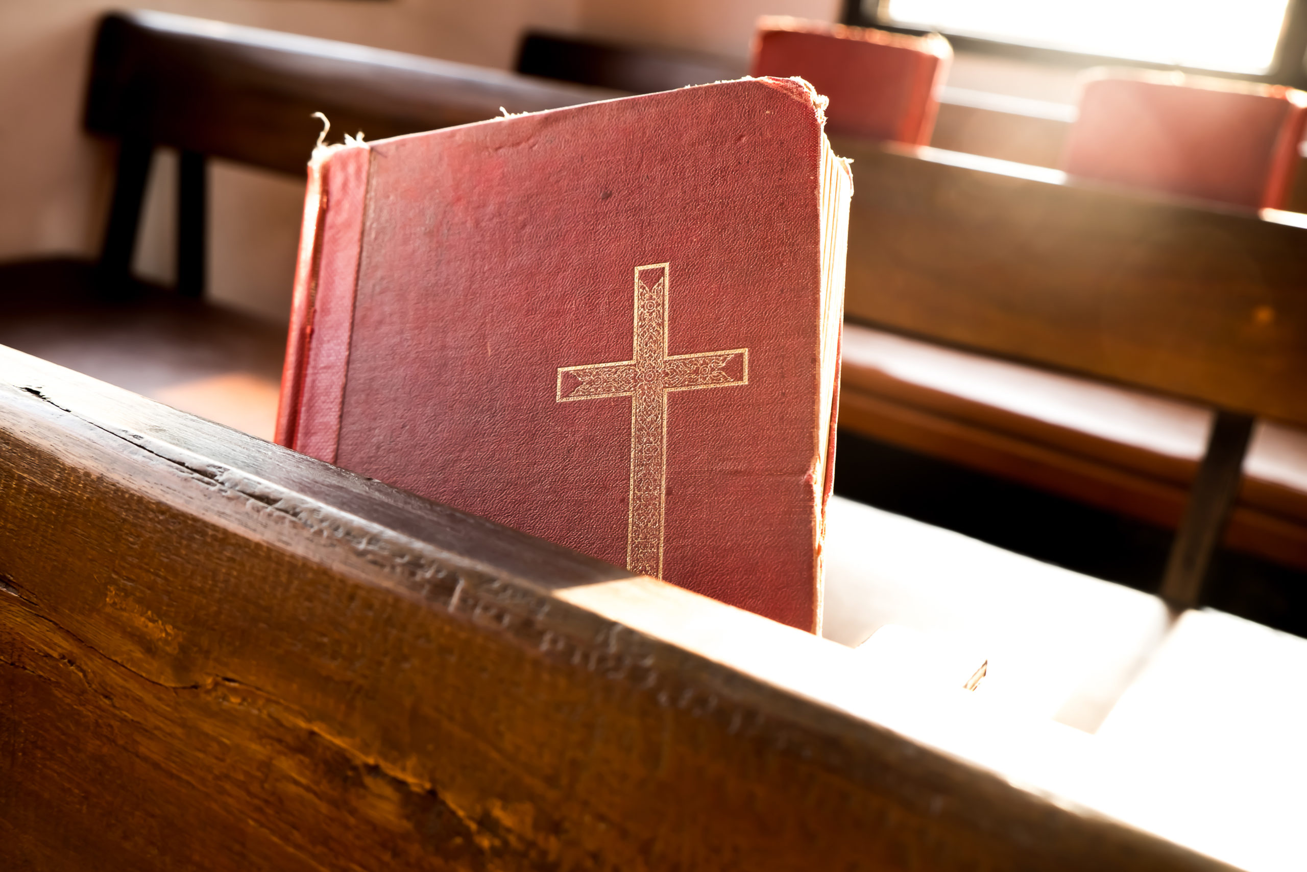 The old red books or red worship songbooks in church