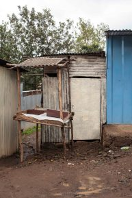 The charcoal shop – a small metal shed with no electricity that also doubles as a storage unit for Elizabteh's wares.