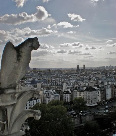 Gargoyle watching atop Notre Dame