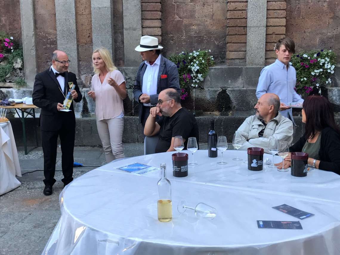 Happiness fills me during the local wine competition. - Now you are ready to take your wine out on the market, says sommelier Claudio Sarti while removing the foil coving the wine which is the winnere of the the white wine competion in Acquapendente in Italy.