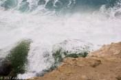 The water crashing the rocks.