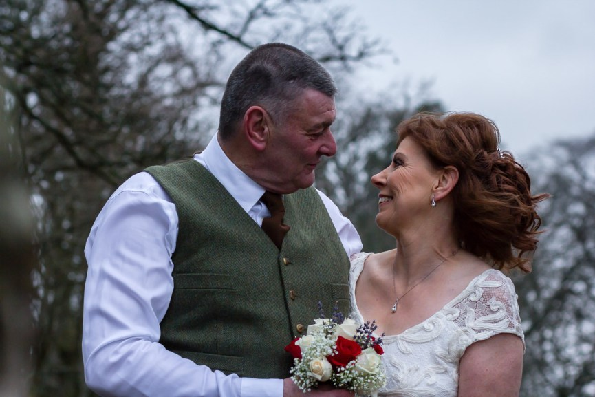 Bride and Groom smiling at Glen Clova Hotel
